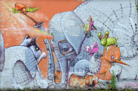 Wall Therapy mural in Rochester, on the side of a building, whimsical elephant, cat, and other animals,