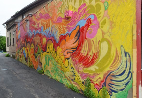mural of bright coloured swirls and curved shapes.