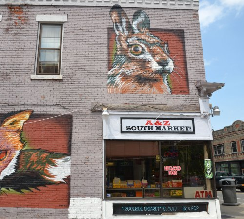 mural painting of a verylarge rabbit head on the second storey of a store, A and Z South Market.