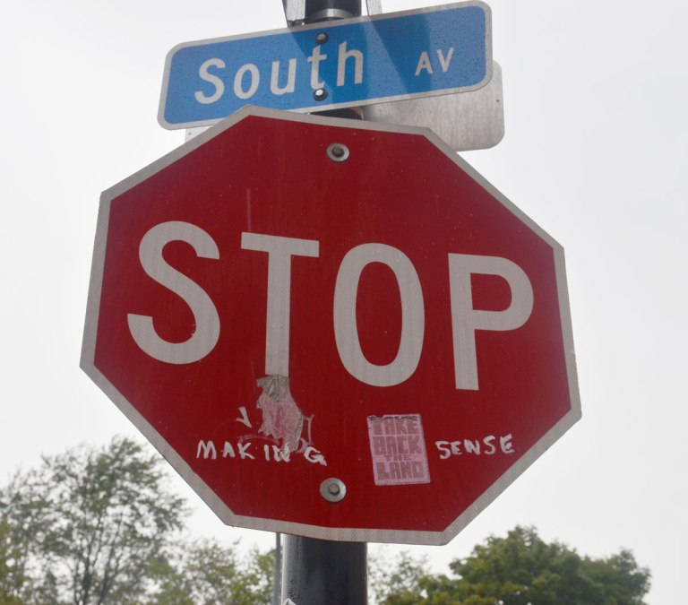 stop sign to which someone has added the words making sense in white paint. stop making sense