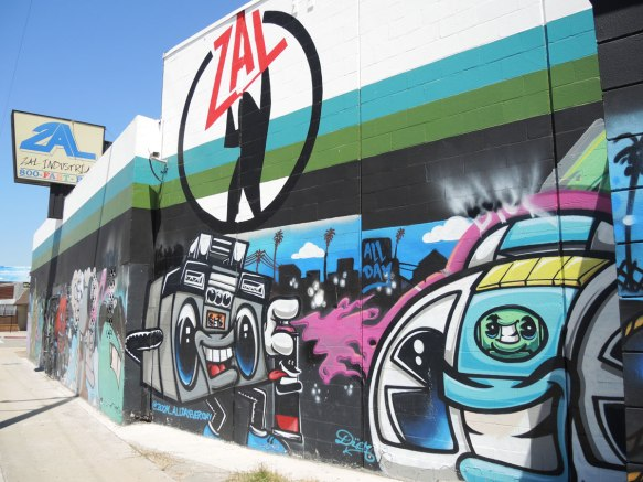 ZAL industrial building on Telegraph Rd in East LA, with wall covered with street art. Boom boxes and ghetto blasters in this photo