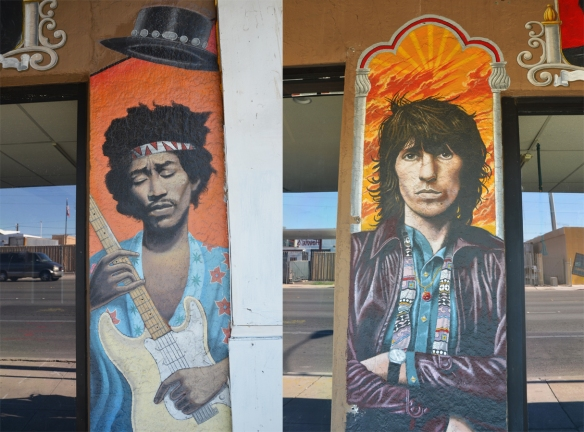portraits of two guitar players painted on the outside of a store, Jimii Hendrix playing a white guitar and Keith Richards standing with his arms folded.
