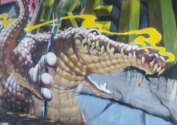 part of a larger mural, a realistic looking crocodile with lots of teeth