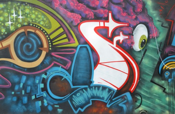 colourful stylized abstract graffiti on a wall, an eyeball included