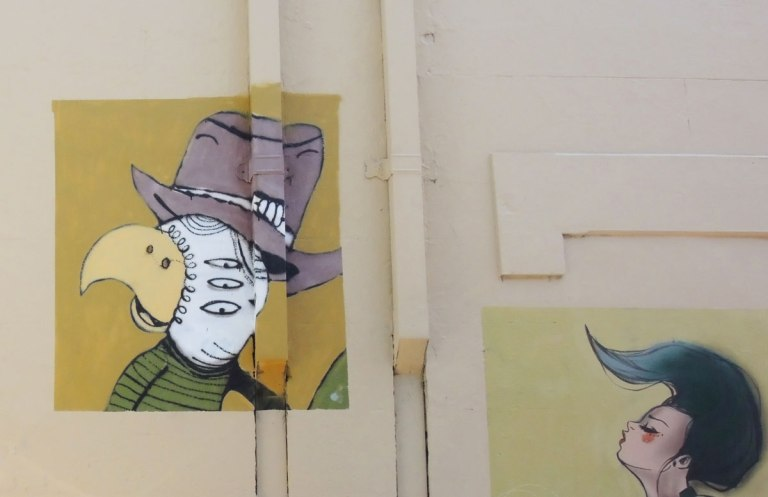 pictures painted on a wall on Goddard street in Newtown, Sydney, Australia