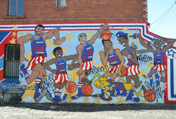 mural of the Harlem globetrotters basketball team bouncing basketballs