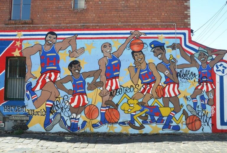 mural of the Harlem globetrotters basketball team bouncing basketballs