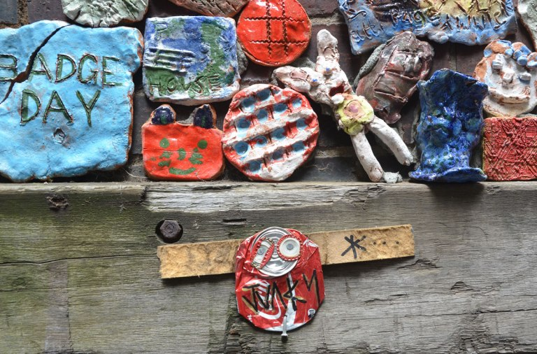 A coke can junky on an exterior wood beam in Drewery Lane, Melbourne, along with some small clay pieces