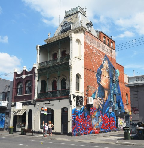 mural of two women, three stories high,