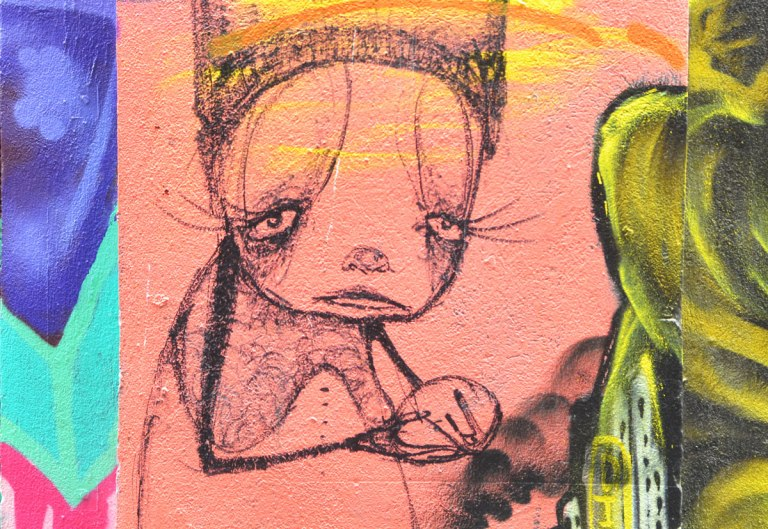street art in a Melbourne alley, a pink girl with long eyelashes and almost cat like feaures, looking very sad, on pink background.