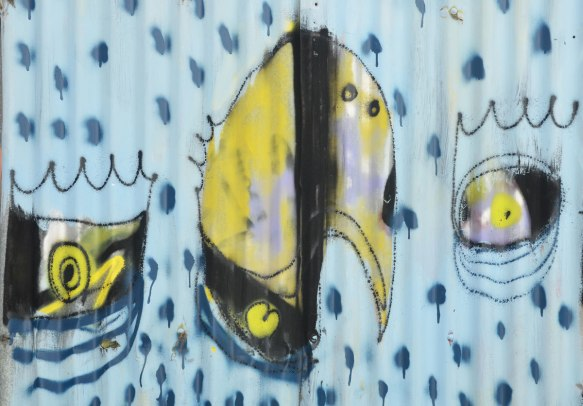 street art painting on corrogated metal fence, light blue background