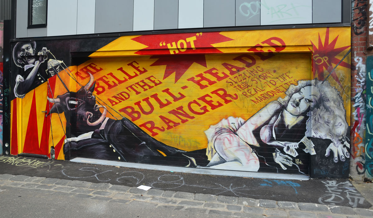mural with the words (red lettering on yellow), The belle and the bull-headed ranger, along with a picture of a bull
