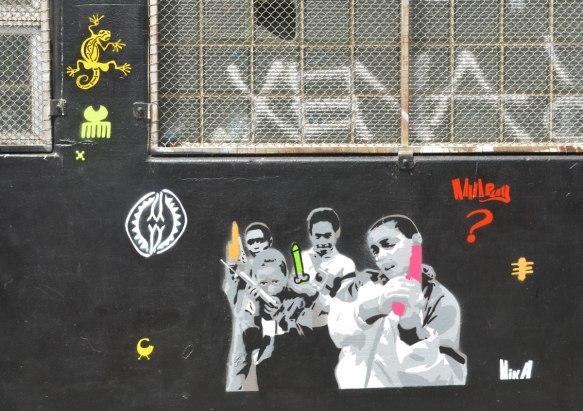 stencils on a black wall