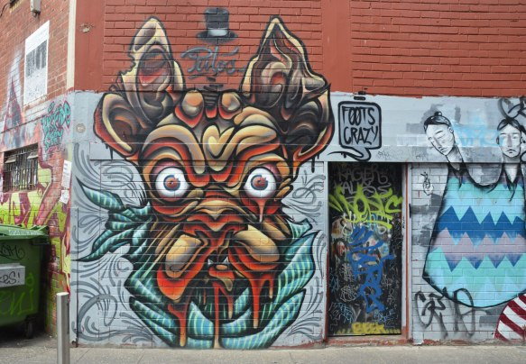 street art painting of un ugly wrinkly dog face with bulging eyes and lots of drool