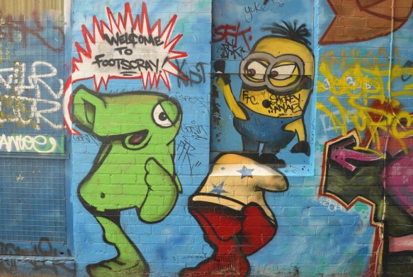 street art painting of a minion, a green turtle like creature