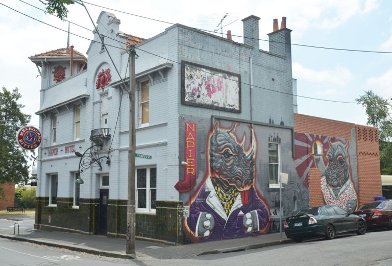 Napier Hotel, with a mural on the side, two animal like creatures, one (on the left) is a rhino