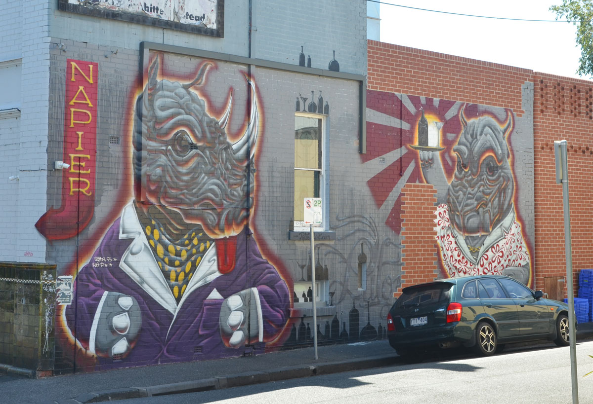 rhinos mural by putos on the side of the Napier Hotel.