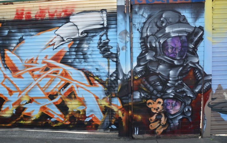 street art mural wearing purple masked space helmets, holding a white flag