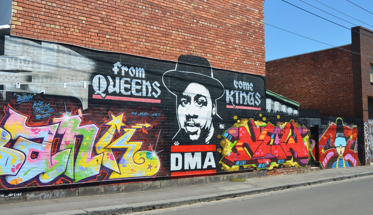 large mural in Fitzroy by kidparis, Peril, and New2, who collectively are the DMA crew, with the words From Queens come Kings, by Da Mad Art, or DMA for short