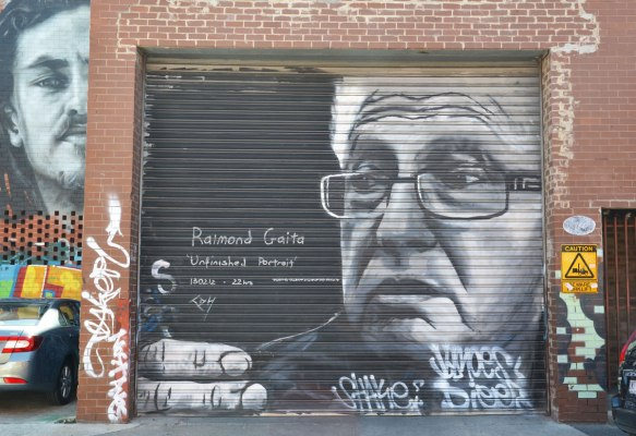 mural in black and white of Raimond Graita on a garage door.