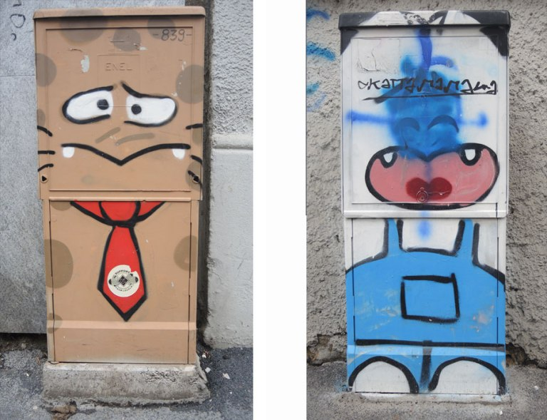 2 metal boxes on the sidewalks in Milan, both with street art. One is brown, a man's face with a scared look and he's wearing a red tie. The other is a stylized woman in blue overalls