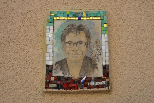 small portrait of a man on a wall.  Hand drawn head and shoulder shot, framed with tiny pieces of mosaic tile - Tingous