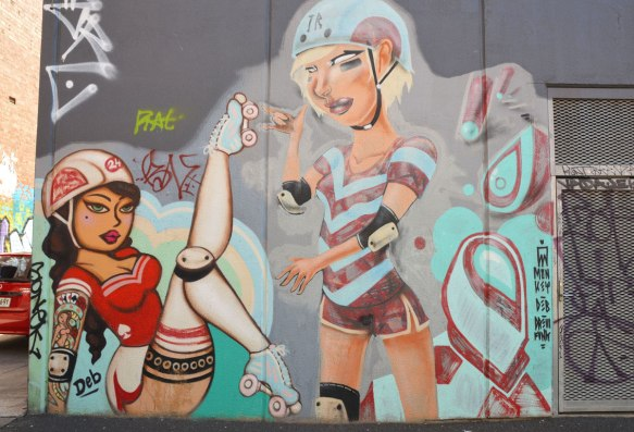a mural showing two women ready for roller derb