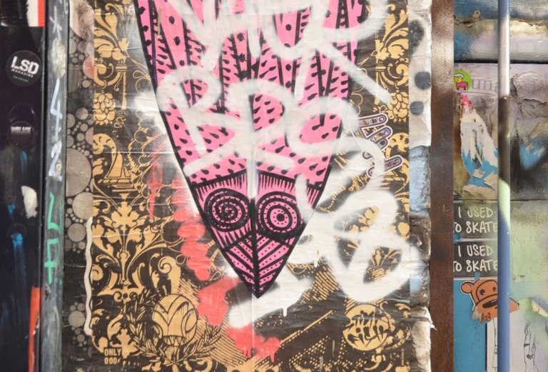 paste up of a large pink mask