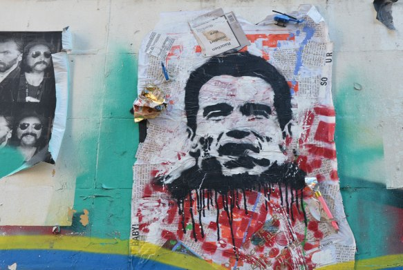 street art picture of Richard Nixon's head, with red paint splattered below.