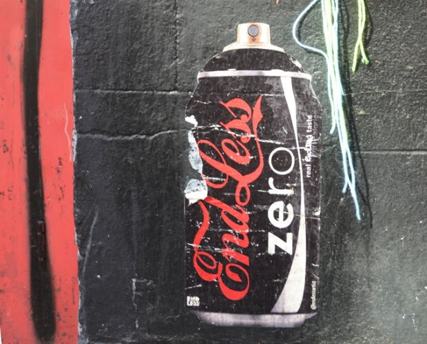 A coke zero black can is turned into a can of spray paint in this street art paste up. Instead of coca cola it says end less