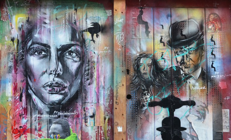 two street art portraits, on the right is character from the TV shaw the Avengers