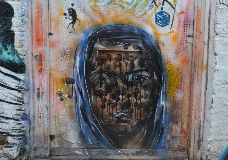 portrait of Malala, by Paul Don Smith, street art, on a door