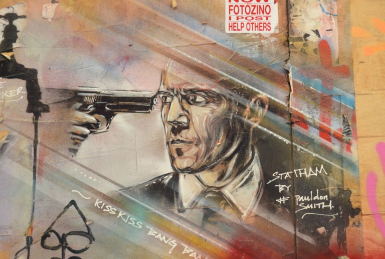 street art portrait of a man with a gun to his head, Statham,
