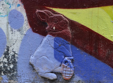 3 dimensional, (3D) bunny rabbit holding a hand grenade, graffiti on a wall