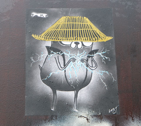 a little creature by Jake Vogt, hat on its head, hands in front almost touching with sparks and lightning being created