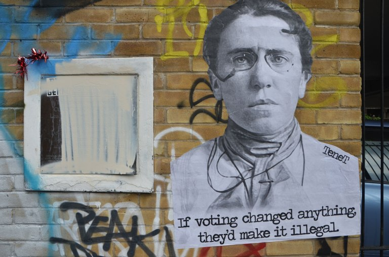 a paste up by Tenet of a woman with glasses and the words If voting changed anything, they'd make it illegal