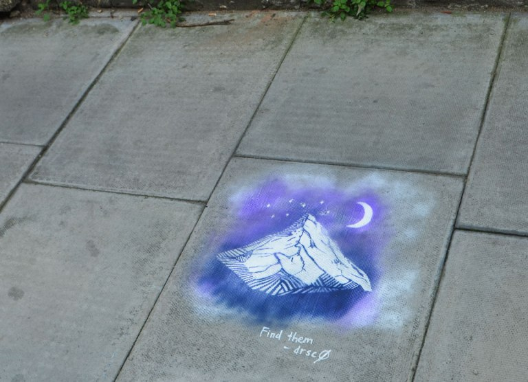 sidewalk stencil of mountain, moon and stars in white on blue and purple background, with words, find them, drsc0 '16