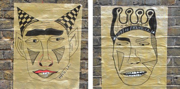 two street art paste up posters on gold paper, both drawings of male figures, one with black and white checkerd horns, the other with a crown.