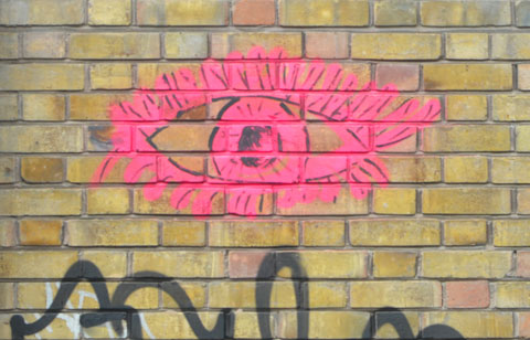 graffiti drawing of a pink eye