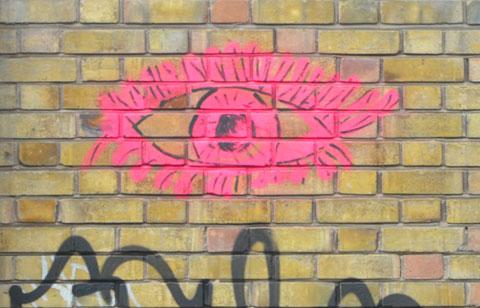 graffiti drawing of a pink eye