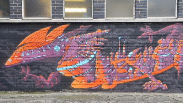 horizontal mural of a long purple and orange dragon
