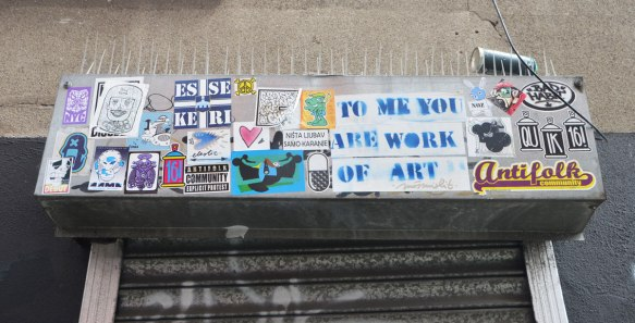 stickers across the top of a doorway, exterior, including one that says To me you are a work of art.