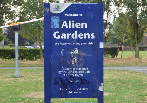blue sign for Allen Gardens that has been altered to say Alien Gardens, city of London , TOwer Hamlets,