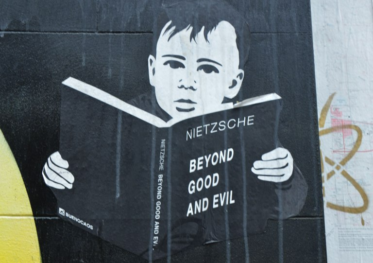 a paste up of a boy reading a book, Neitzsche's Beyond Good and Evil