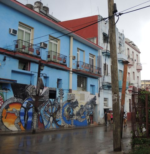 colouful mural on a blue building in havana cuba