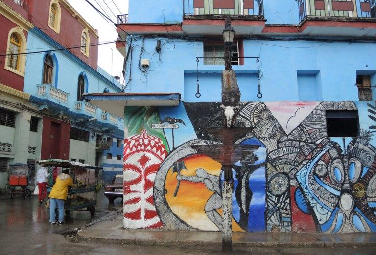 colouful mural on a blue building in havana cuba