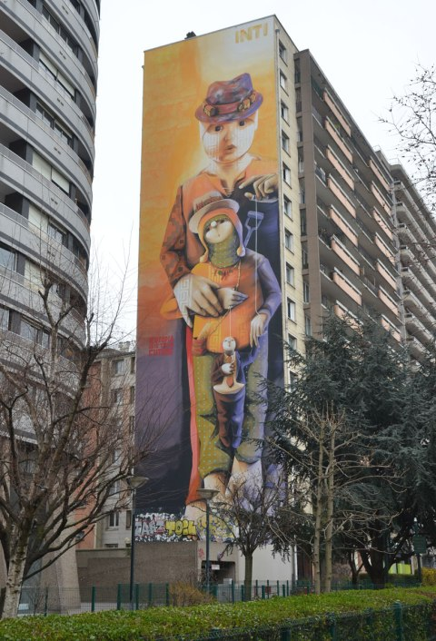 a large multi storey vertical mural on the side of an apartment building in Paris called 'Our Utopia is Their Future' by inti -