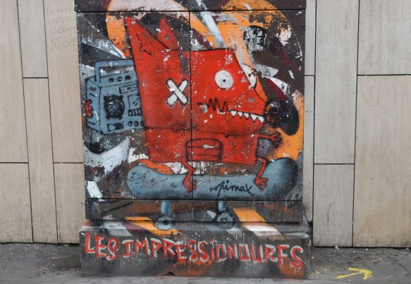 on a metal box on the sidewalk pavement beside a street, a red creature with a band aid on its cheek rides on a skateboard while holding a ghetto blaster near its ear . The words les impressionoures is written below him