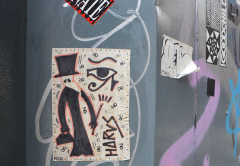 a mcln plague doctor paste up with the word horus on it as well as an eye