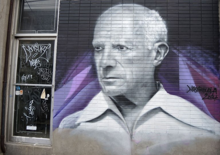 realistic painting of a man in a white shirt, on a purple background, mural
